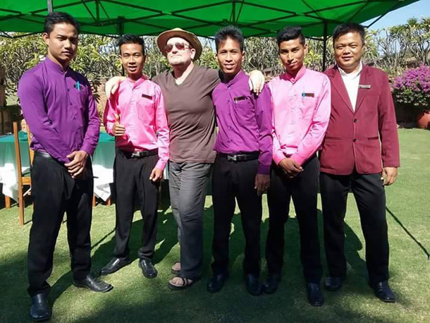 Bono, the stage name for Paul David Hewson of the Dublin-based band U2, poses with staff of the hotel he stayed at in Bagan, Mandalay Division.  (Photo: Facebook / Bagan Thiripyitsaya Sanctuary Resort)