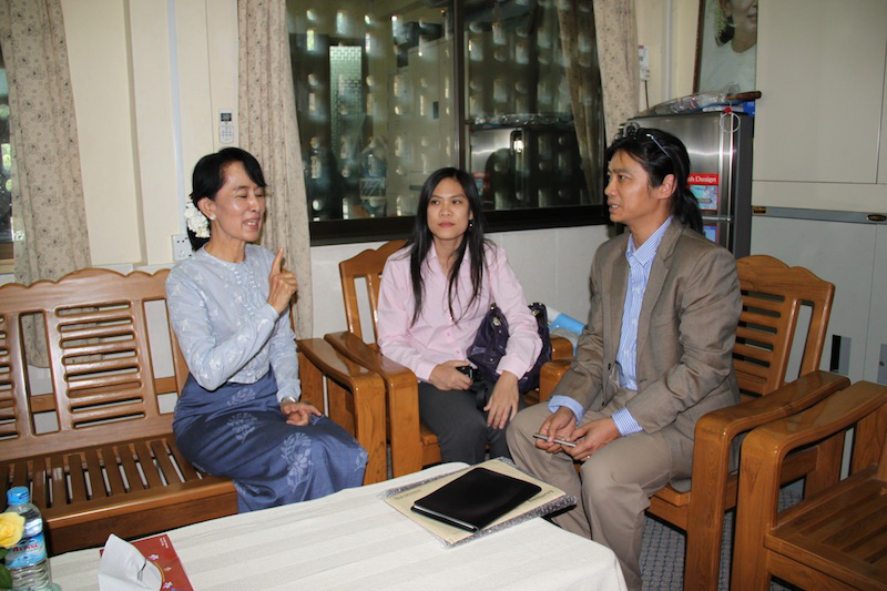 The author speaking with Aung San Suu Kyi at the NLD's office in Rangoon in January 2012. (Photo: The Irrawaddy)