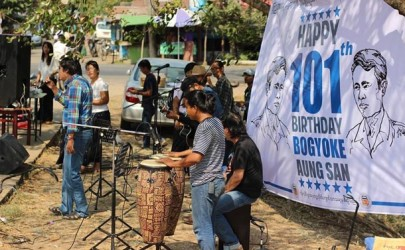 Students from the Yangon Institute of Economics celebrate General Aung San's 101st birthday on Wednesday. (Photo: Yangon Institute of Economics Students' Union / Facebook)