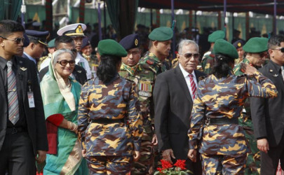 Bangladesh's President Abdul Hamid (3rd R) and Prime Minister Sheikh Hasina (2nd L) during the celebration of the country's 45th Victory Day, at the national parade ground in Dhaka, December 16, 2015.  (Photo: Ashikur Rahman / Reuters)