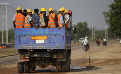 Workers are transported via truck to the site of the Thilawa Special Economic Zone (SEZ) project at Thilawa, May 8, 2015. (Photo: Soe Zeya Tun / Reuters)