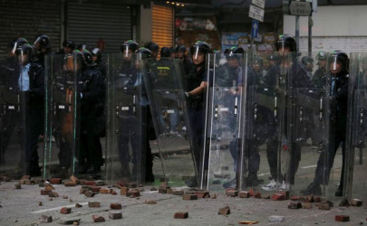 Stones thrown by protesters are seen on the ground in front of riot police during a clash at Mong Kok district in Hong Kong, China, February 9, 2016.  (Photo: Bobby Yip / Reuters)