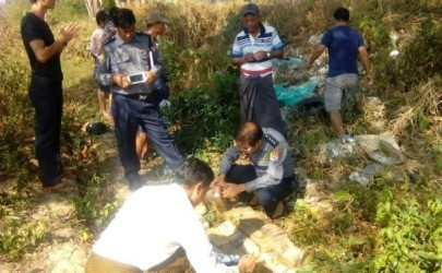 Police inspect the dumping site in Mingaladon Township where the abandoned drugs were found. (Photo: Yangon Police / Facebook)