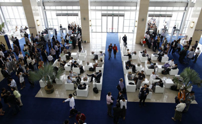 People sit in the reception at the World Economic Forum on June 5, 2013, in Naypyidaw, where foreign investment into Burma was a main topic of discussion. (Photo: Reuters)