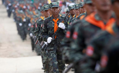 Soldiers from the Shan State Army-South march in formation during a military parade celebrating the 69th Shan State National Day at Loi Tai Leng, the group's headquarters, on the Thai-Burma border, February 7, 2016. (Photo: Soe Zeya Tun / Reuters)
