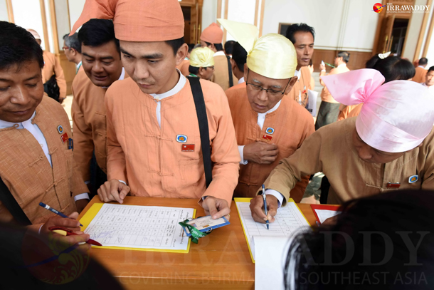 Lawmakers sign in ahead of a parliamentary session in Naypyidaw on Monday, February 8, 2016. (Photo: JPaing / The Irrawaddy)