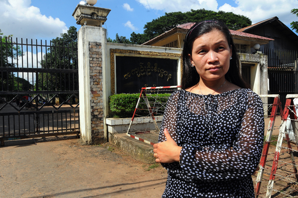 Peace activist May Sabe Phyu stands in front of Insein Prison, where her husband Patrick Khum Jaa Lee was detained while awaiting trial for defamation charges in 2015. He is now serving a six-month sentence. (Photo: Steve Tickner / The Irrawaddy)