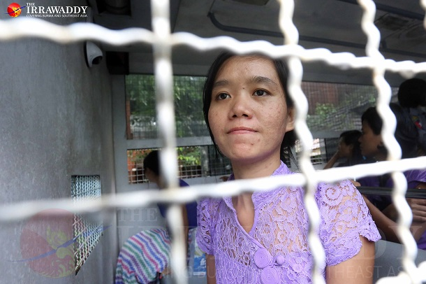 Phyoe Phyoe Aung, general secretary of the All Burma Federation of Student Unions, inside a police detention vehicle before a court hearing in Tharawaddy. (Photo: JPaing / The Irrawaddy)