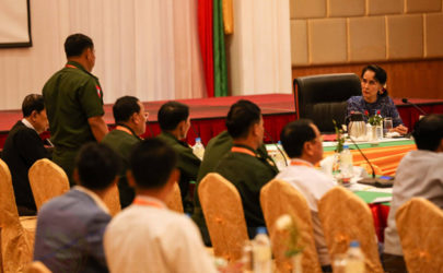 State Counselor Aung San Suu Kyi, upper right, meets with members of the Joint Monitoring Committee in Naypyidaw on Wednesday. (Photo: Hein Htet / The Irrawaddy)