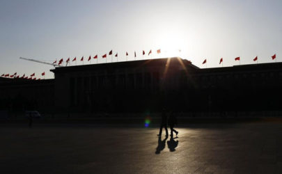 People walk across Tiananmen Square in front of the Great Hall of the People, the venue of the National People's Congress, in Beijing on March 1, 2011. (Photo: Reuters)