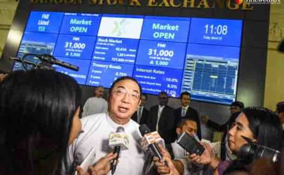 Maung Maung Thein, the outgoing chairman of the Securities and Exchange Commission, speaks to reporters at the launch of the Yangon Stock Exchange on March 25 in Rangoon. (Photo: JPaing / The Irrawaddy)