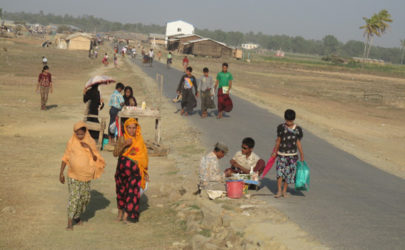 Rohingya outside a displaced people's camp in Arakan State in 2014. (Photo: Lawi Weng / The Irrawaddy)