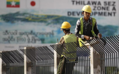 People work at the site of the Thilawa Special Economic Zone (SEZ) project at Thilawa on May 8, 2015. (Photo: Soe Zeya Tun / Reuters)