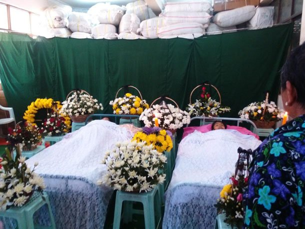 The bodies of two Kachin schoolteachers lie in wake in Muse, northern Shan State, in January 2015. (Photo: Maran Naw Di Awng / Facebook)