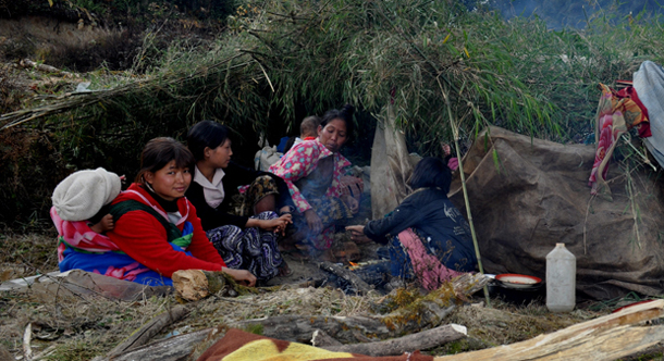 Women and children take shelter as they flee fighting in Burma's Kachin State. (Photo: The Irrawaddy)