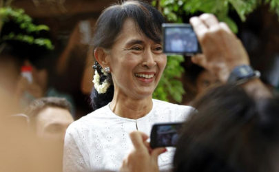 Burma's then opposition leader Aung San Suu Kyi smiles at people gathered to meet her at the Mae La refugee camp, near Mae Sot at the Thailand-Burma border, on June 2, 2012. (Photo: Reuters)