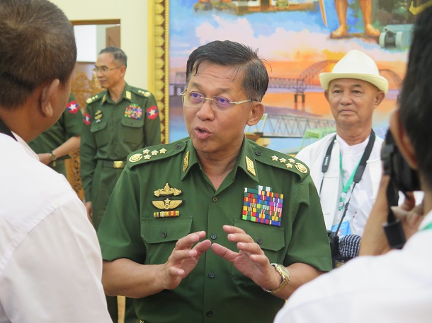 Snr-Gen Min Aung Hlaing talks with journalists after his press conference on May 13. (Photo: Htet Naing Zaw / The Irrawaddy)