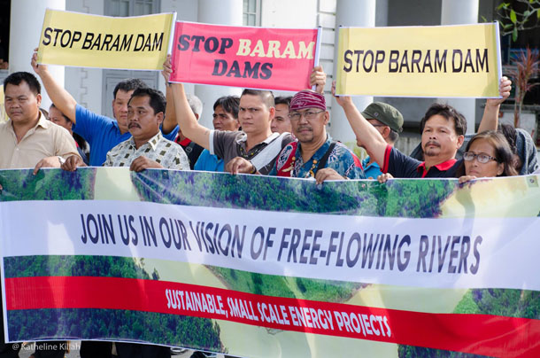 Protestors hold banners against the Baram mega-dam project in Sarawak, part of Malaysian Borneo. (Photo: SAVE Rivers Network)