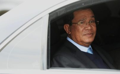 Cambodia's Prime Minister Hun Sen looks out from a car as he arrives for a Russia-Asean summit at Sochi International Airport in Russia on May 18, 2016.  (Photo: Reuters)