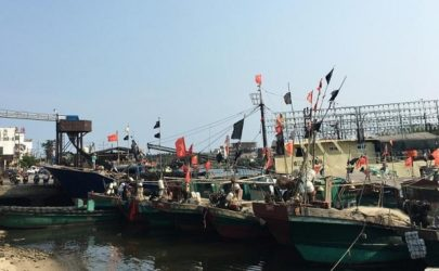 Fishing boats with Chinese national flags are seen at a harbor in Tanmen, Hainan province, on April 5, 2016.  (Photo: Reuters)