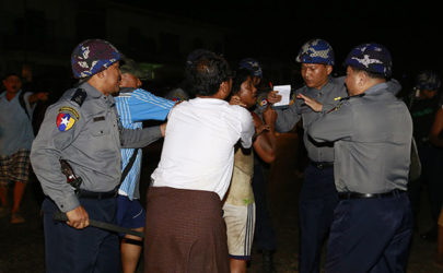 Riot police detain a man in Hlegu, outside Rangoon, late April 4, 2014. (Photo: Soe Zeya Tun / Reuters)