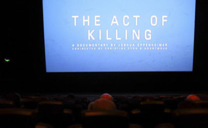 "People watch ""The Act of Killing,"" a documentary about the 1965-66 anti-communist atrocities, in Jakarta onFeb. 6, 2013. (Photo: Reuters)"