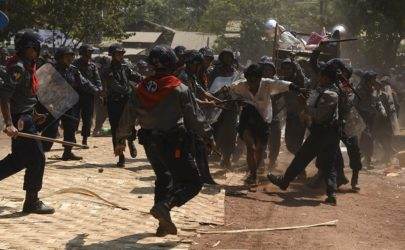 Police beat a student protester who had attempted to turn himself in during a crackdown on the activists at Letpadan on March 10, 2015. (Photo: Sai Zaw / The Irrawaddy)