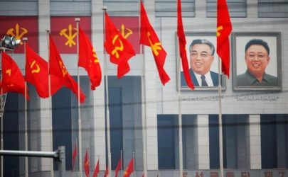 Pictures of former North Korean leaders Kim Il-sung and Kim Jong-il decorate the April 25 House of Culture, venue of the Workers' Party of Korea congress in Pyongyang, North Korea, on May 6, 2016. (Photo: Reuters)