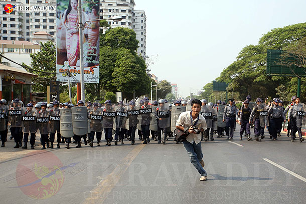 Police wait for demonstrators in Rangoon on March 10, 2015. (Photo: JPaing / The Irrawaddy)