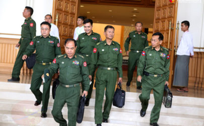Militarily appointed lawmakers leave a session of Parliament in February. (Photo: Myo Min Soe / The Irrawaddy)