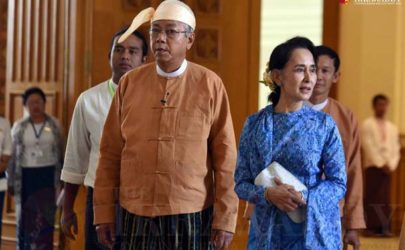Aung San Suu Kyi, right, and President Htin Kyaw enter Parliament in March 2016. (Photo: The Irrawaddy)