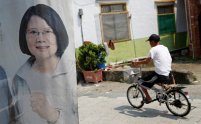 A man rides a bicycle past a flag with the image of Taiwan President-elect Tsai Ing-wen in Pingtung, Taiwan, on April 27, 2016. (Photo: Reuters)