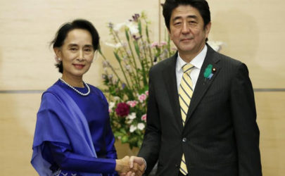 Then opposition leader Aung San Suu Kyi, left, shakes hands with Japan's Prime Minister Shinzo Abe at his official residence in Tokyo on April 18, 2013. (Photo: Reuters)