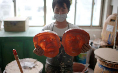 A worker checks masks of US Republican presidential candidate Donald Trump at Jinhua Partytime Latex Art and Crafts Factory in Zhejiang Province, China, on May 25, 2016. (Photo: Reuters)