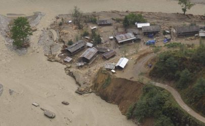 An aerial view of homes affected by flooding in Kachin State. (Photo: Burma Army Commander-in-Chief's Office)
