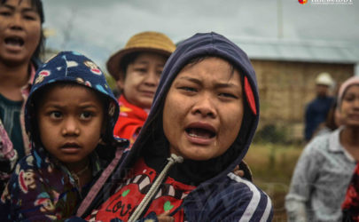 People in Rangoon Division's Mingaladon Township watch as their homes are demolished on Jan. 26, 2015, after they were deemed squatters. (Photo: JPaing / The Irrawaddy)