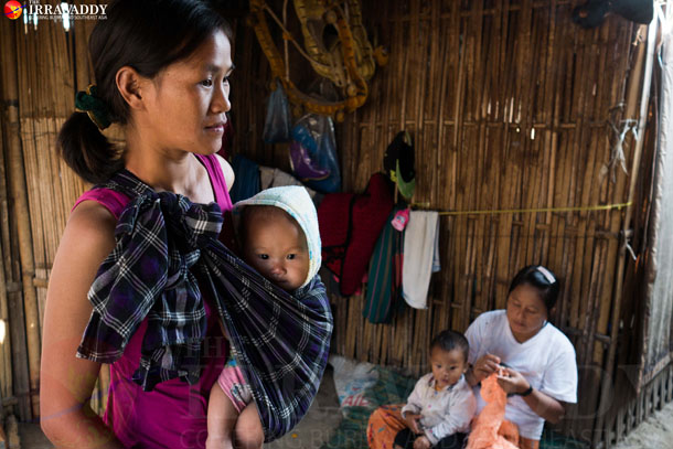 A young ethnic Kachin mother photographed with her child at an IDP camp in Bhamo on December, 2015. (Photo: Tin Htet Paing / The Irrawaddy)