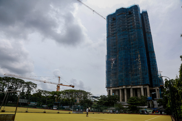 In picture, a high-rise condominium is under construction at Theinbyu Sporting Ground. (Photos: JPaing / The Irrawaddy)