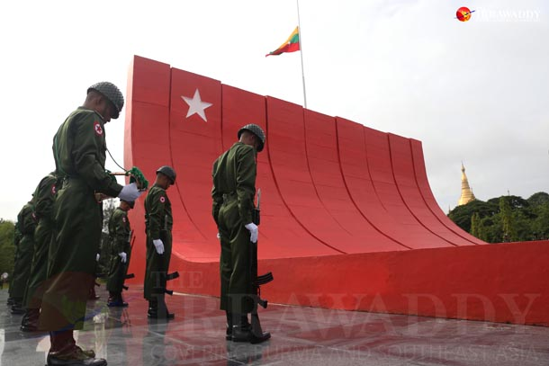 An honor guard pays respect to Gen Aung San and his colleagues at the mausoleum on July 19, 2015. (Photo: Hein Htet / The Irrawaddy)