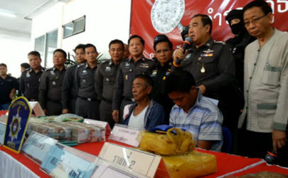 Wa leader Tat Ma Har, also known as Ma Ma (seated left), at a press conference at a narcotics control office in Chiang Mai, Thailand on Thursday.