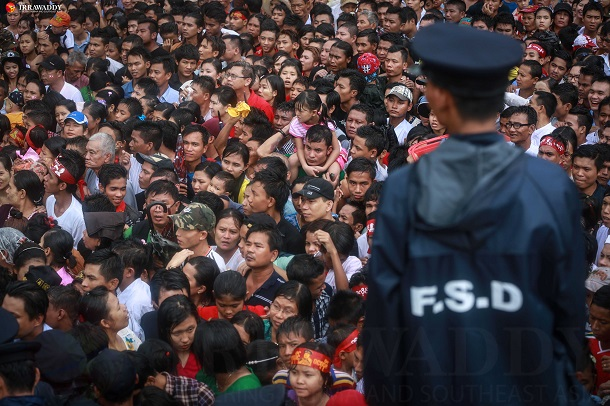 Visitors are seen at the Martyrs' Mausoleum in Rangoon on July 19, Martyrs' Day. (Photo: Hein Htet / The Irrawaddy)