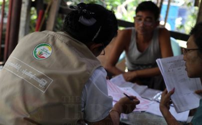 Residents of Rangoon's Thaketa Township participate in Burma's first nationwide census in more than three decades. (Photo: Hein Htet / The Irrawaddy)