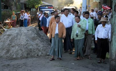 Pegu Division Chief Minister Win Thein inspects the cholera-affected area in Pyay on July 26, 2016. (Photo: Kaung Myat Min / The Irrawaddy)