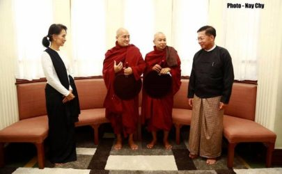 Aung San Suu Kyi receives Commander-in-Chief Snr-Gen Min Aung Hlaing at her Rangoon residence for a Buddhist merit-making ceremony with monks on this year's Martyrs' Day, July 19. (Photo: Yawainwe Inn Ma / Facebook)