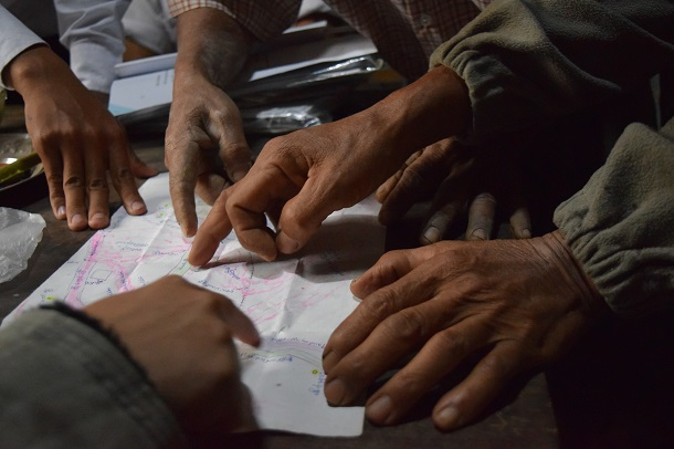 Farmers in Sagaing Division use a hand drawn map to discuss where their land, government projects, and other resources are located. (Photo: Namati)
