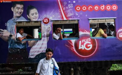 "Ooredoo advertisement on a train on Rangoon's ""circle"" line (Photo: Pyay Kyaw / The Irrawaddy)"