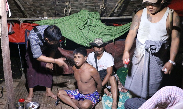 Police raid the house of Maung Maung Oo in Western Khone Thar Village near Kalay, Sagaing Division, on June 26. He was arrested earlier for drug possession, but no drugs were found in his home. (Photo: Swe Win / Myanmar Now)