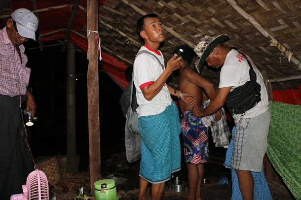 Police raid the house of Maung Maung Oo in Western Khone Thar Village near Kalay, Sagaing Region, on June 26. He was arrested earlier for drug possession, but no drugs were found in his home. (Photo: Swe Win / Myanmar Now)