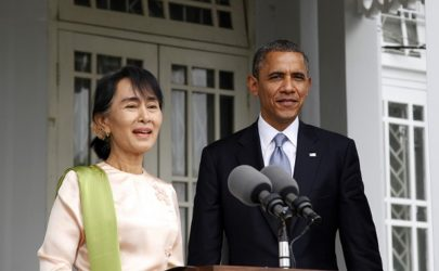Aung San Suu Kyi speaks to journalists after meeting with US President Barack Obama, right, at Suu Kyi's lakeside residence in Rangoon during the President's first trip to Burma in November 2012. (Photo: The Irrawaddy)