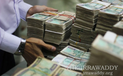 Stacks of Burmese kyat await counting in Rangoon. (Photo: Jpaing / The Irrawaddy)